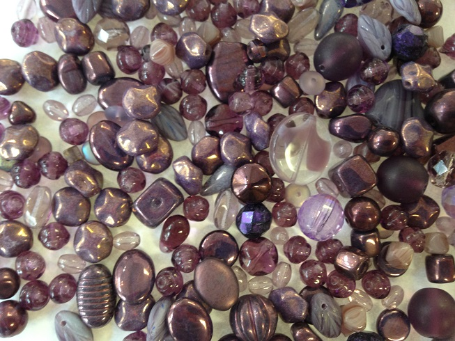 A 25 gram mix of Czech seed beads, Amethyst