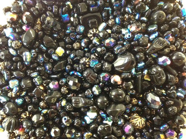 A 25 gram mix of Czech seed beads, Jet